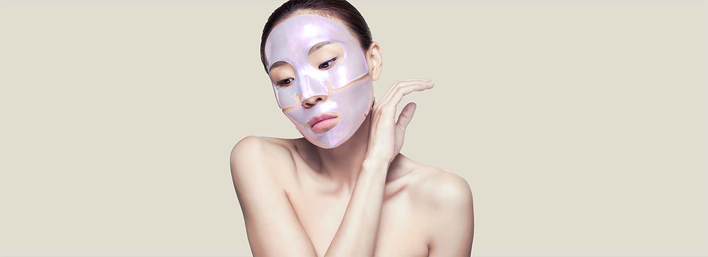 woman wearing diamond collagen face mask
