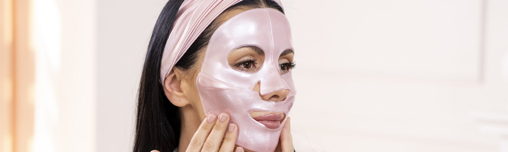 woman putting on diamond collagen face mask